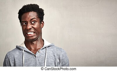 Man disgusted - Black man disgust face expressions portrait...