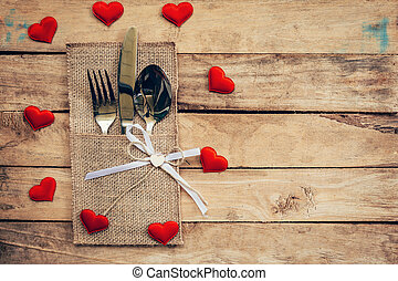 Table set for celebration Valentine's Day. Wooden table...