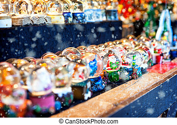Snow Globes at Christmas Market - Rows of snowglobes at an...