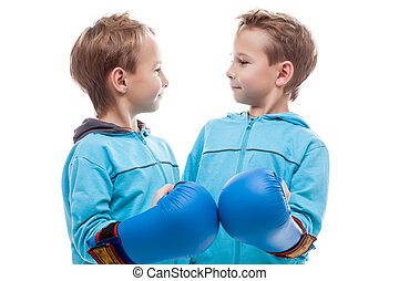 Cute twin boys posing looking at each other, close-up