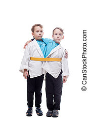Image of little twin boys pretending siamese, isolated on...