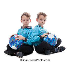 Image of amusing twin brothers posing with balls, isolated...