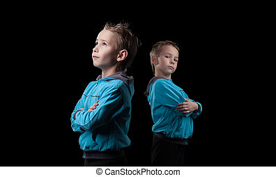 Nice little twins isolated on black background - Image of...