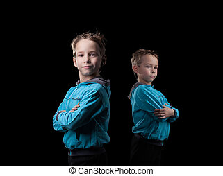 Studio shot of serious little twin brothers, close-up