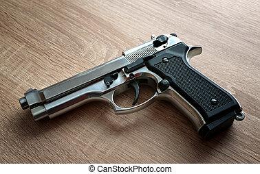 Pistol on a wooden board.