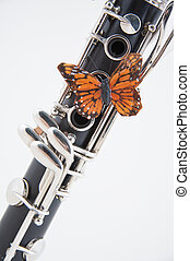 Clarinet with Butterfly on White - A soprano clarinet with a...