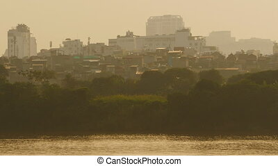 Hanoi city in the evening haze 2. Overlooking the river. Vietnam.