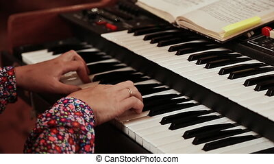 Hands of a woman playing the organ in catholic church.