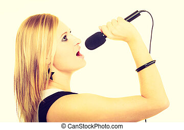 Pretty woman with microphone singing.