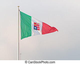 tricolour triangular flag of Italian republic fluttering in...