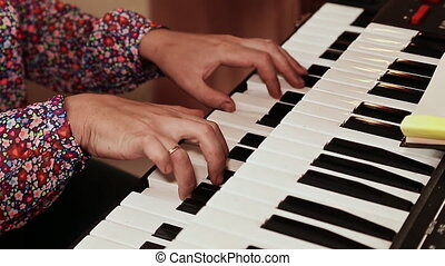 Hands of a woman playing the organ in catholic church 2 -...