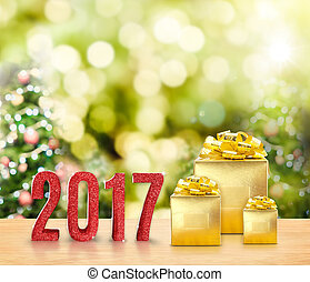 2017 red glitter and Golden present on wood table with...