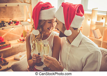 Beautiful couple celebrating Christmas