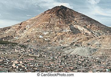 "El Cerro Rico which translates "" the rich hill"" stands above..."