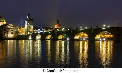 Famous landmark Charles bridge at night timelapse zoom out