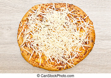 Whole pizza - Round whole pizza with freshly grated...