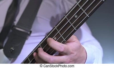 Musicians. View of guitarist playing in studio, close-up