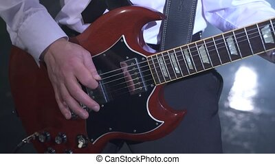 Music. View of guitarist's hands while he playing -...