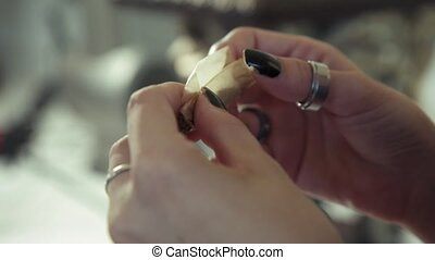 Woman Preparing Hashish Joint Rolling Marijuana Cigarette...