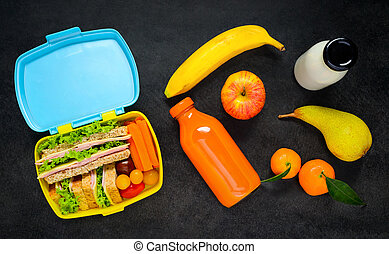 Lunch Box with Food and Drink - Top View of Lunch Box with...