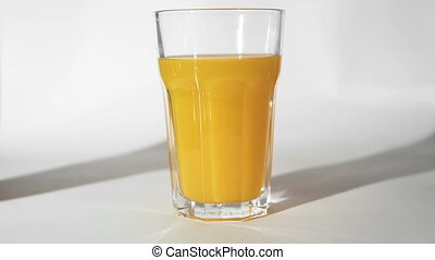 Orange Juice and Rolling Fruit - Fresh orange juice pour...