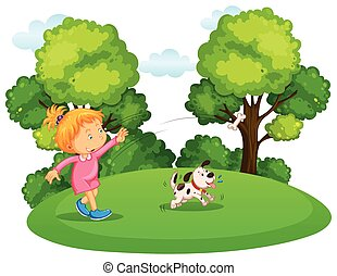 Girl playing with pet dog in park