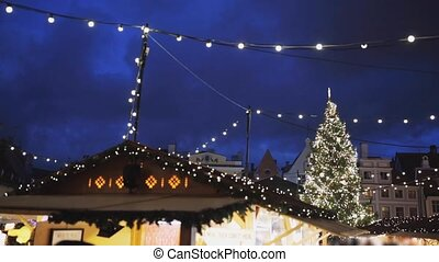 illuminated christmas tree and old city fair - winter...