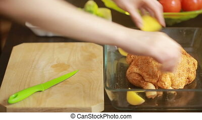 Cooking chicken with vegetables in a glass baking in the...