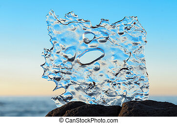 Frozen abstract ice - Frozen water on the seashore in winter