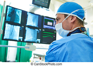 Interventional cardiology. Male surgeon doctor at operation...