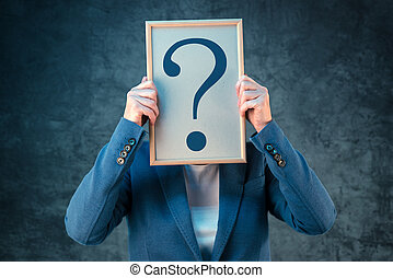 Business woman with question mark looking for answers