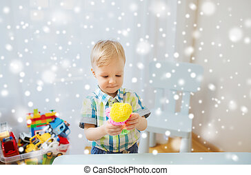 happy little baby boy with ball clay at home - childhood,...