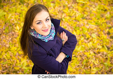 Top view of a beautiful girl against the backdrop of autumn...
