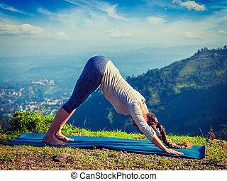 Young sporty fit woman doing yoga oudoors in mountains -...