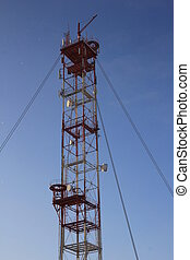 white-red telecommunication tower
