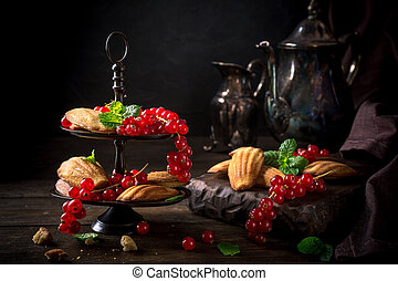 Homemade anise cookies Madeleine with red currant and mint...