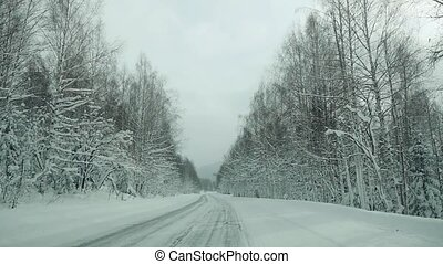 Car driving on snow road in slowmotion. 1920x1080 - Car...