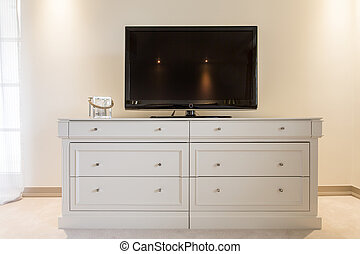 Flat screen TV on cabinet - Flat screen TV standing on the...