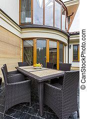 Backyard with dark rattan furnitures - Backyard of a modern...