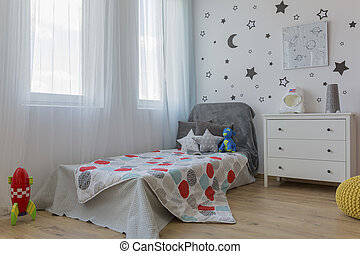 Bed in space themed bedroom - Comfortable small bed in cozy...