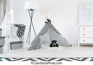Black and white child room with carpet, tent and dresser