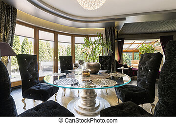 Luxurious dining room with glass table