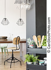 Communal table and industrial lamps - Apartment with...