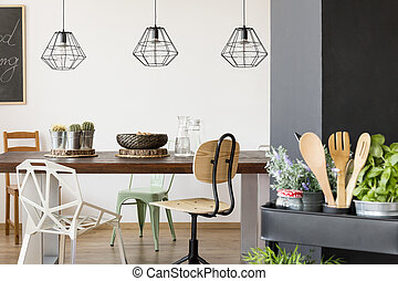 Communal table and pendant lamps - Room with communal table,...