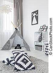 Room with play tent, carpet, pattern pillows and crate...