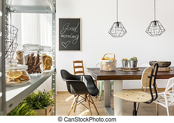 Dining area in industrial style with table, chairs and...