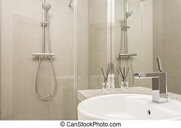 Beige bathroom with glass shower - Bathroom lined with beige...