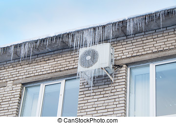 roof of the house and air conditioning in icicles.Heating...