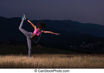 black woman doing yoga in the nature - young beautiful black...