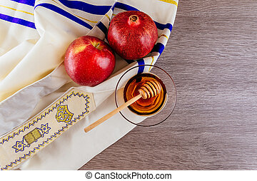 shofar horn , white prayer talit and pomegranate isolated on...